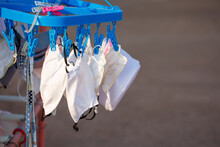 Disposable Medical Mask Hanging On Pegged Clothesline For Reused In Some Case, Due To Lack Of Disposable Medical Mask Of Novel Coronavirus (COVID-19) Situation.