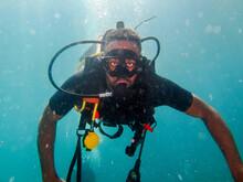 Black Man Diving In A Deep Sea Looking Ahead.