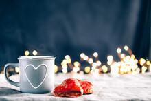 Heart Shaped Red Hand Made Cookies And A Coffee Mug.
