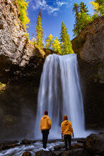 Wells Gray British Colombia Canada, Couple On Vacation Visit Spectacular Water Flow Hikingof Helmcken Falls On The Murtle River In Wells Gray Provincial Park Clearwater, British Columbia,