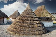 Neolithic Straw Cone-shaped Houses On Display Near Stonehenge In England