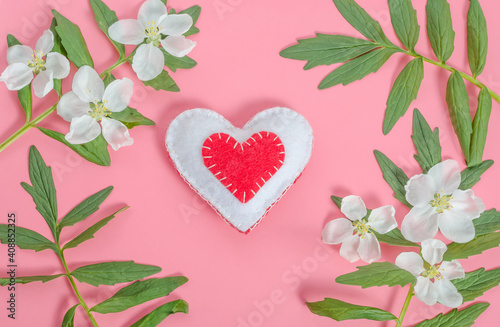 Obraz Valentine's day card, red heart with a frame of flowers on a pink background - fototapety do salonu