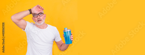 attractive adult man exhausted from sports drinking Fotobehang
