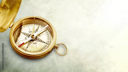 Fototapeta Old style brass compass on desk