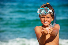 Happy Boy Collect Shells On The Beach Show Them To The Camera Wearing Snorkeling Mask