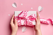 Gift Box With Big Bow On Pink Background
