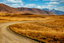 Gravel Road Winding Its Way Through The Valleys And Between The Southern Alps In Hakatere Conservation Park In The Ashburton Lakes District