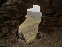 Views From Inside A Cave Towards A Deep Ravine In Gran Canaria