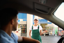 Man In Car Speaking With Gas Station Worker