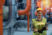 Service Engineer Women On Chiller Plant On Background.