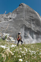 Young Woman Admiring Big Rock In Castle Hill. Narnia Movie Set In New Zealand