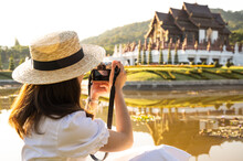 Rear View Of Tourist Woman Shooting Beautiful View Of Ho Kham Royal Pavilion An Iconic Symbol Of Royal Park Rajapruek In Chiang Mai Province Of Thailand.