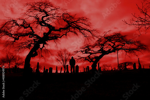 Fototapeta Scary pic of cemetery with hellfire sky and scary trees