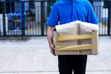 Asian Delivery Man In Blue Uniform He Emotional Falling Courier Courier Showing Damaged Box, Cheap Parcel Delivery, Poor Shipment Quality.