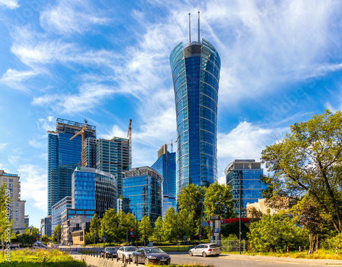 Fototapeta Warsaw Spire office tower of Immofinanz at rising above Wola business district of Warsaw, Poland obraz