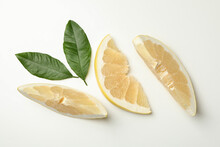 Ripe Pomelo Fruit Slices With Leaves On White Background