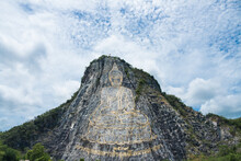 Carved Golden Buddha Laser Image 130 Mtr High On The Cliff At Khao Chee Chan, Thailand