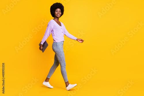Canvas Print Full body profile photo of pretty dark skin person walking arm hold laptop isola