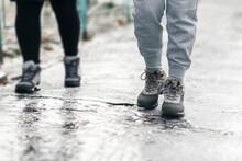 Pedestrians Glide Along The Icy Sidewalk. Winter Ice On Footpaths.