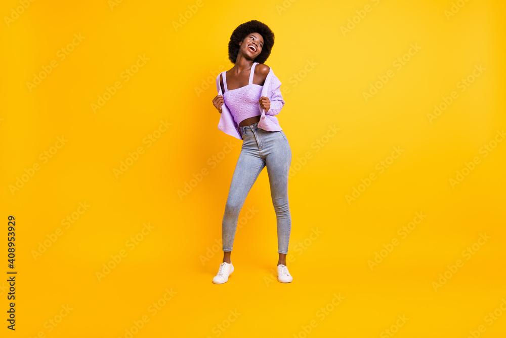 Fototapeta Full size portrait of nice dark skin person look empty space enjoy dancing wear purple isolated on yellow color background