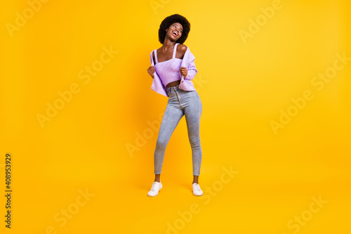 Obraz Full size portrait of nice dark skin person look empty space enjoy dancing wear purple isolated on yellow color background - fototapety do salonu