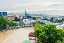Beautiful View Of Kura River And Bridge Of Peace In Tbilisi, Georgia