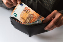 The Man Puts 50 Euros In His Wallet.