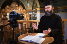 . Priest Online. An Orthodox Priest Is Recording A Video For His Blog. Preaching During A Pandemic.