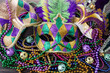 canvas print picture - A group of Venetian and New Orlean Mardi gras mask with colorful beads on dark background