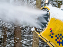 Close Up Detail With A Snow Cannon Or Snow Gun Throwing Snow On The Ski Slope