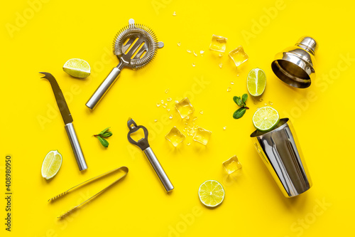 Mojito cocktail set with bar tools and utensils with lime and mint, flat lay © 9dreamstudio
