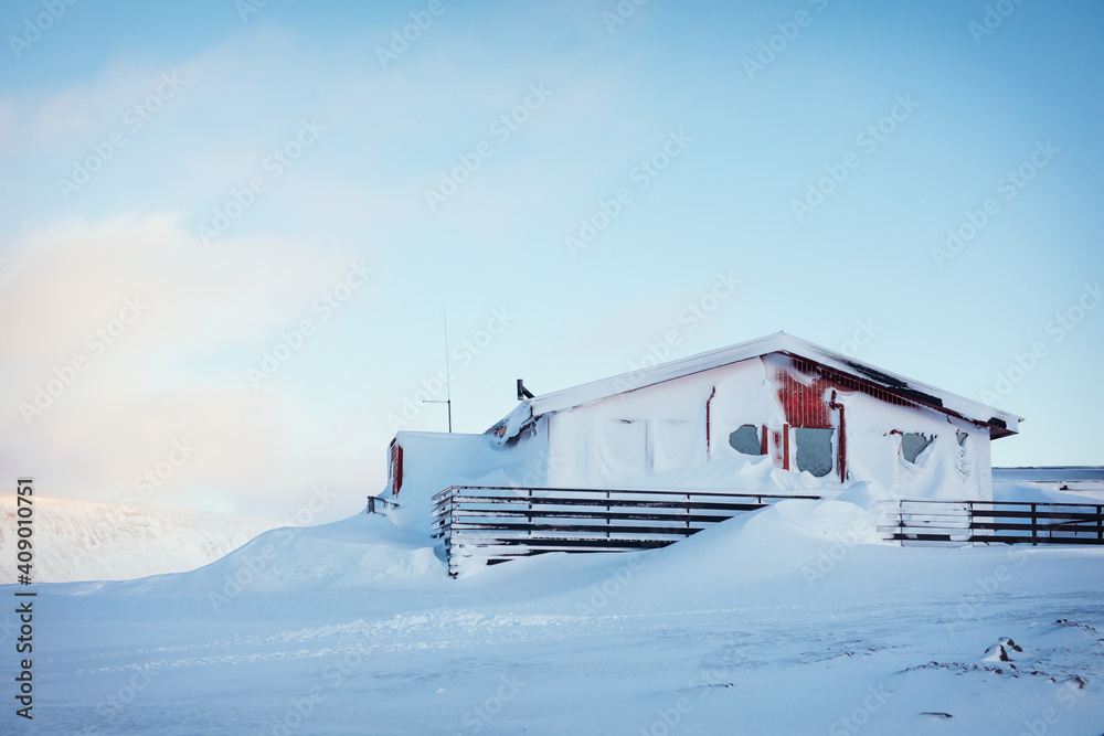Fototapeta House covered in snow after a strong winter blizzard