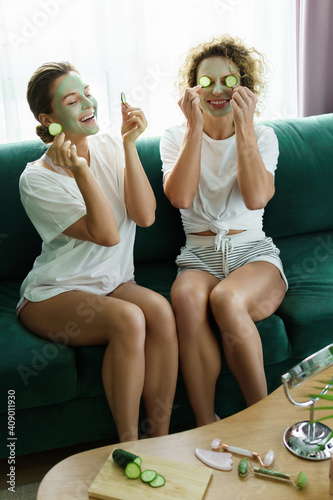 Fototapety, obrazy: Two beautiful girls with applied facial masks during spa day