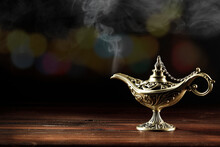 Magic Lamp On A Wooden Table In The Dark Night