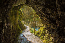 The Footpath Along The Tolminka River Which Flows Through Tolmin Gorge Cuts Through A Rock Tunnel In The Triglav National Park, North Western Slovenia