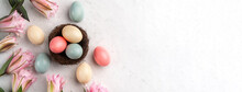Colorful Easter Eggs In The Nest With Pink Double Lily Flower.