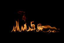 Abstract Blaze Fire Flame Texture For Banner Background.Texture Of Fire Flames  On A Black Background. Real Fiery Bonfire For Creative Design Elements