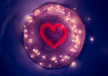 Blurred Red Heart In A Garland, Knitted Texture, Blue Purple Colors, Glowing Bokeh Lights, Valentine's Day, A Symbol Of Love