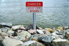 Warning Sign DANGER: KEEP OFF ROCKS