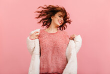 Magnificent Young Woman In Coat Dancing With Pleasure. Studio Shot Of Lovely Brunette Girl Isolated On Pink Background.