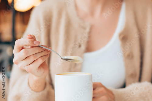 Canvas Print Girl in a cafe with a cup of hot latte coffee
