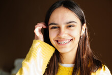 Cute And Happy Teen Girl With Braces Smiling To Camera