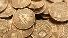 Group Of Golden Bitcoin Coin Scattered. Popular Digital Currency. Cryptocurrency Created, Distributed, Traded, And Stored In Decentralized Ledger System Known As A Blockchain.