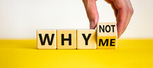 Why Not Me Symbol. Businessman Turns A Cube And Changes Words Why Me To Why Not. Beautiful Yellow Table, White Background. Business And Why Not Me Concept. Copy Space.