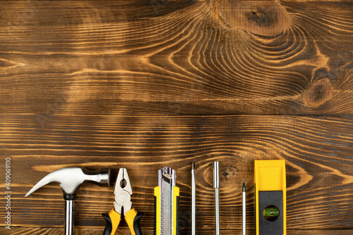 Obraz Top view of yellow construction instruments and tools on wooden DIY workbench with copy space at center. - fototapety do salonu