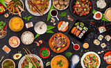 Fototapeta Kawa jest smaczna - Asian food served on black stone table, top view, space for text. Chinese and vietnamese cuisine set.
