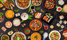 Asian Food Served On Black Stone Table, Top View, Space For Text. Chinese And Vietnamese Cuisine Set.