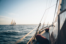 A Schooner In Maine Bay Viewed From Another Sailboat During Late Day