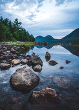 Acadia's Bubbles Reflected In A Calm Jordan Pond On A Summer Evening