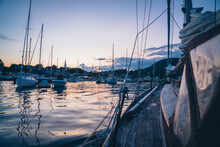 Sailing Through The Boats In Camden Harbor, Maine During Blue Hour